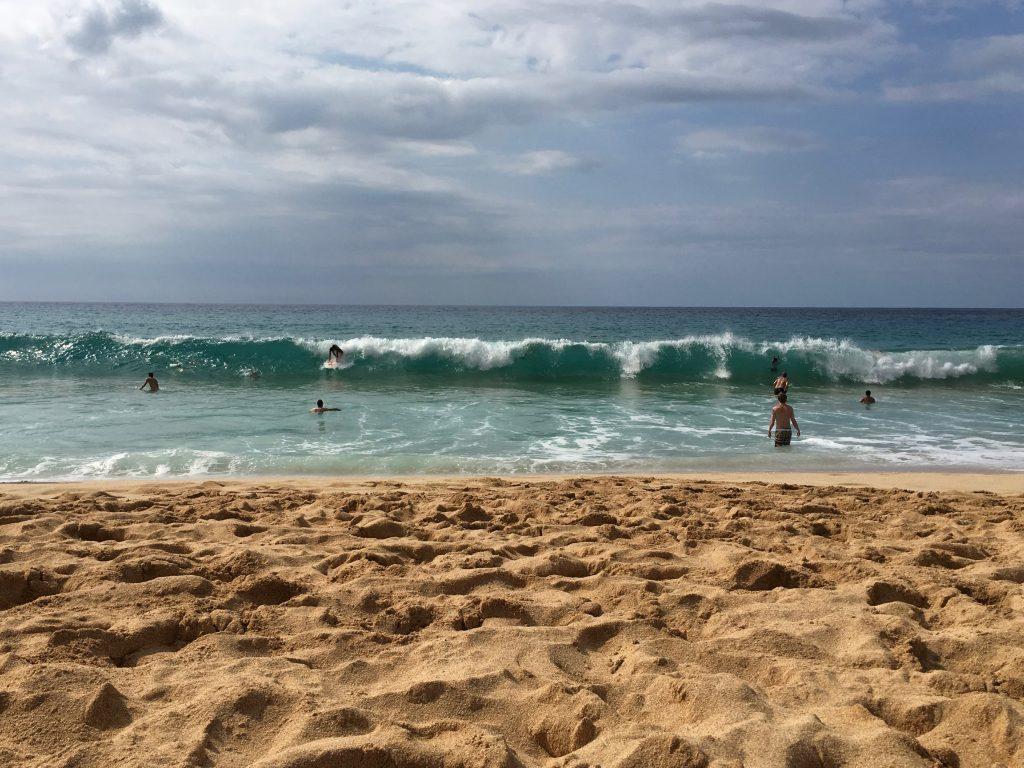 Surfing at Waimea Bay